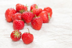 Strawberries. Fresh ripe strawberries on a crinkled white surface Stock Images