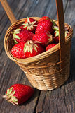 Strawberries. Fresh strawberries in a basket on a wooden table Stock Photo