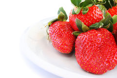 Strawberries. In plate on white background Royalty Free Stock Image