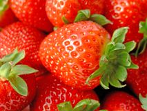 Strawberries. Close-up of lots of ripe strawberries with green leaves Royalty Free Stock Photos