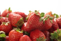 Strawberries. A lot of Strawberries in a white studio background Stock Images