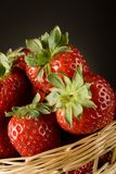 Strawberries. Fresh red strawberries on green background Stock Images