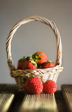Strawberries. Basket with strawberries  on a wooden table Stock Photos