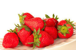 Strawberries. Red strawberries in a plate, on white background Stock Images