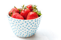 Strawberries. Studio shot of a cup full of strawberries Royalty Free Stock Photos
