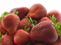 Strawberries. Photo of a pile of ripe strawberries with a white background Stock Image