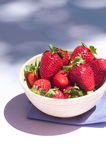 Strawberries. In a wood bowl and purple towel Royalty Free Stock Photo