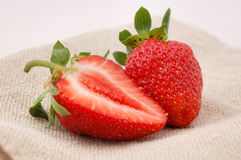 Strawberries. Two strawberries on the table Royalty Free Stock Image