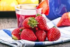 Strawberries. Orange apple and juice Stock Image