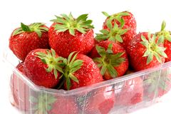 Strawberries. Box of fresh strawberries on white background Royalty Free Stock Photography