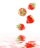 Strawberries. A bunch of strawberries falling in water Stock Photo