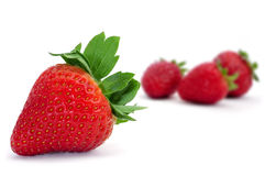 Strawberries. Some appetizing strawberries on a white background Royalty Free Stock Images
