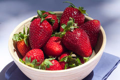 Strawberries 4. Strawberries in a wood bowl and purple towel Royalty Free Stock Photography