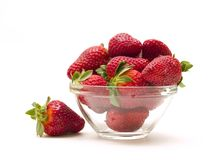 Strawberries. Glass cup of strawberries on white background stock photography