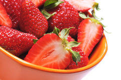 Strawberries. Close up of a group of fresh, succulent strawberries in orange cup stock photos