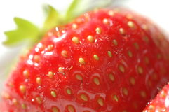 Strawberries. For everyone. Closeup on a pair of fresh stock image