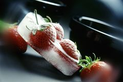 Strawberries. In ice. June, Poland Stock Images