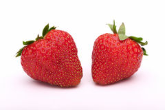 Strawberries. Two fresh strawberries on a white background Royalty Free Stock Photography