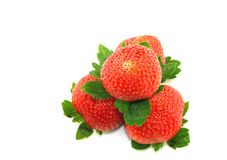 Strawberries. Stacked Strawberries Isolated on White with Selective Focus in front Royalty Free Stock Photos
