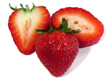Strawberries. This is a composition of a strawberry and a cut strawberry stock photography