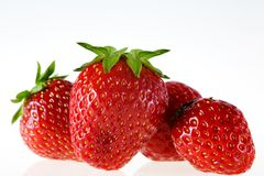 Strawberries. Some delicious strawberries in front of white background Stock Photo