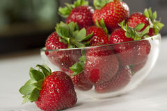 Strawberries. A bowl of strawberries on a table Stock Image