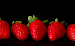 Strawberries against Black Royalty Free Stock Photos