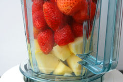 Strawberries And Apple In Blender Stock Photo