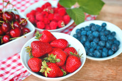 Strawberries and another organic berry fruits Royalty Free Stock Image