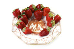 Strawberries on antique porcelain plate on an isol Royalty Free Stock Images