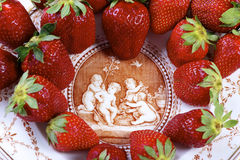 Strawberries on antique porcelain plate on an isolated Stock Photo