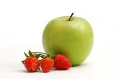 Strawberries and apple Royalty Free Stock Photos