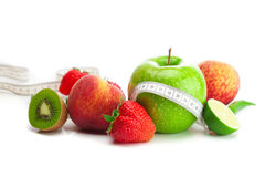 Strawberries,apple,lime,peach,kiwi  and tape Stock Images