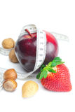 Strawberries,apple,nuts and measure tape Royalty Free Stock Photos