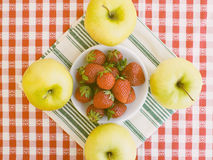 Strawberries with apples around Royalty Free Stock Photo