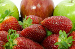 Strawberries and apples closeup Stock Images