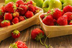 Strawberries and apples royalty free stock photo
