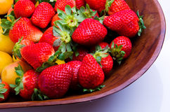 Strawberries and apricots. Delicious pile of strawberries and apricots over wood Stock Images