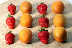 Strawberries and apricots Stock Image