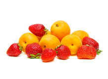 Strawberries and apricots on a white background. Ripe strawberries and apricots on a white background Stock Photo