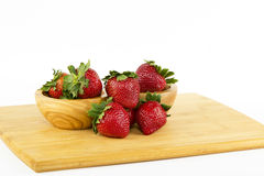 Strawberries arranged on a cutting board Stock Images
