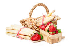 Strawberries and asparagus. In basket Stock Photography