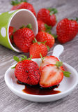 Strawberries and balsamic vinegar Stock Photos