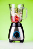 Strawberries And Bananas With Kiwifruit In A Mixer. Close up of some fresh fruits in a mixer Royalty Free Stock Photo