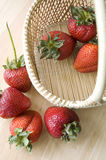 Strawberries basket. Fresh strawberries with basket in summer Stock Photo