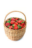 Strawberries in a basket. Fresh ripe red strawberries in a basket on a white background Stock Image