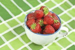 Strawberries. In a basket. Delicious seasonal fruit Stock Photos