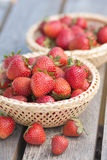 Strawberries. In basket on garden table Stock Images