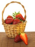 Strawberries in a basket, isolated Royalty Free Stock Photo