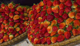 Strawberries. A basket of strawberries at a market Stock Images